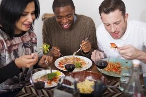 Three friends having healthy dinner